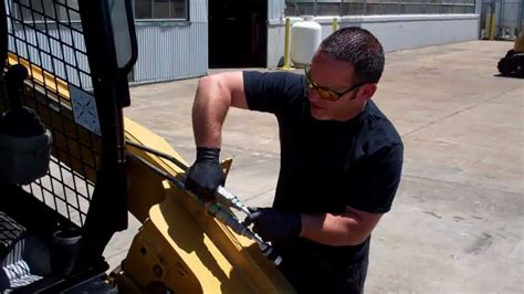 release auxiliary hydraulic pressure   cat  skid steer loader youtube