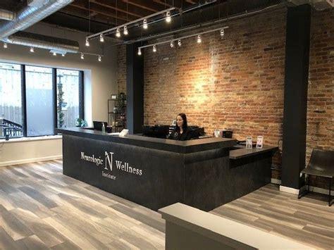 Black Front Desk with Exposed Brick   Lobby interior ...