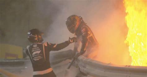 Grosjean's visor melted as he sat in burning wreckage of ...