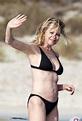 MELANIE GRIFFITH in Black Bikini on Vacaton in Ibiza 07/04 ...