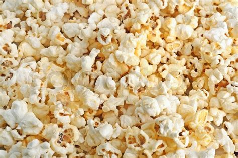 popcorn background background from salted fluffy fresh popcorn grains stock