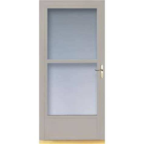 larson retractable screen door shop larson 36 in w almond retractable screen door