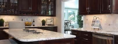 granite top kitchen island cart brown kitchen cabinets backsplash idea backsplash
