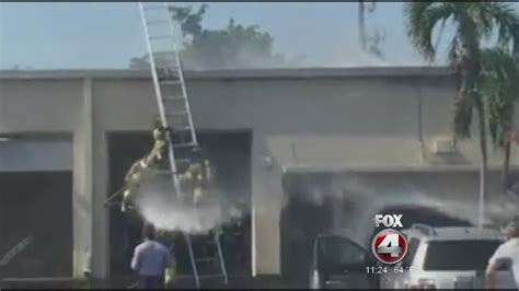 A firefighter falls off a ladder while putting out a fire ...