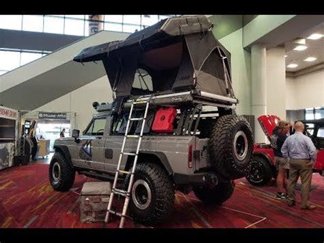 overland jeep wagoneer called  tomahawk sema show