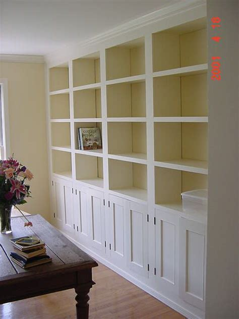 Bookshelves As Room Focus by Floor To Ceiling Built Ins With Bookshelves And Cabinets