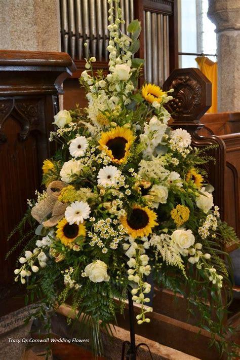 sunflower pedestal arrangement weddings church wedding