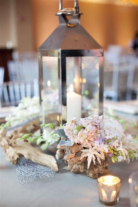 lantern centerpieces  driftwood  white blush