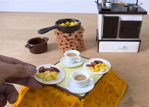 miniature kitchen set cooks miniature breakfast with tiny kitchen set