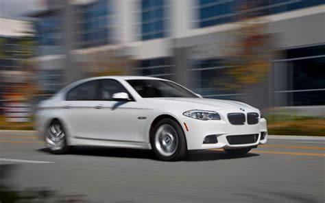 2012 Bmw 528i Front Three Quarter In Motion Photo 1