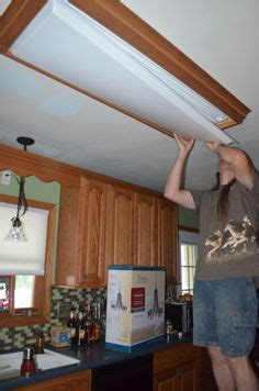 replacing fluorescent light in kitchen how to replace fluorescent lighting with a pendant fixture 7762