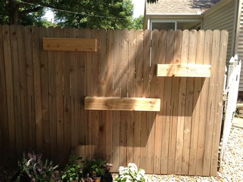 unfinished diy fence mounted garden planter boxes in the