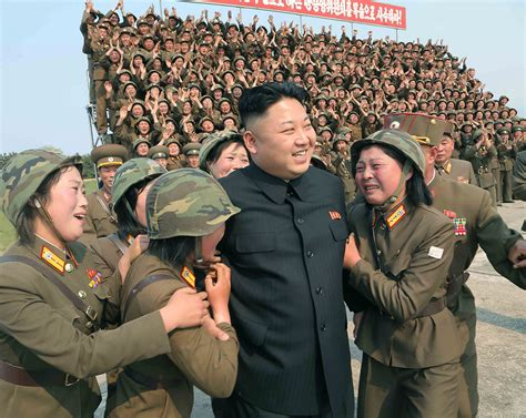 Photos Of North Korea Leader Kim Jong-un Surrounded By