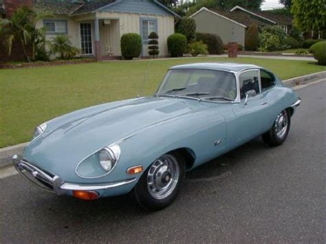 light blue e type jaguar beyond