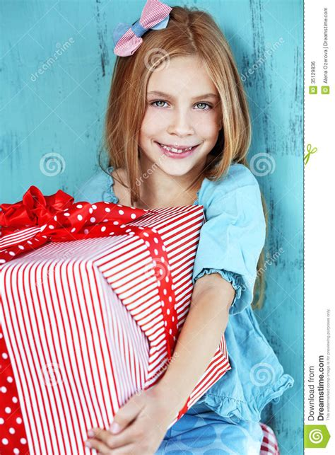 Child holding big gift stock photo. Image of person ...