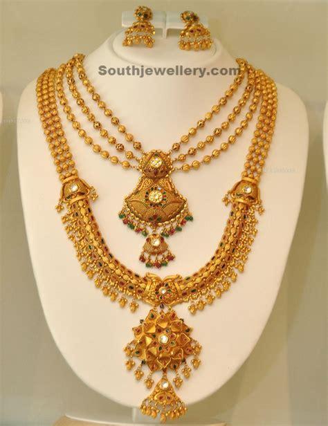 Gold Jewellery By Khazana  Jewellery Designs. Gold Bangle Bracelet With Diamonds. Silver Elephant Anklet. Long Chains. Diamond Cut Bands. Cross Bracelet. Heart Lockets. Green Stone Bracelet. Team Rings