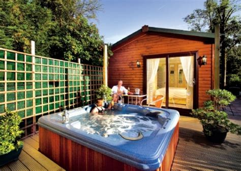 lake windermere log cabins with tubs lake district accommodation and things to do discover