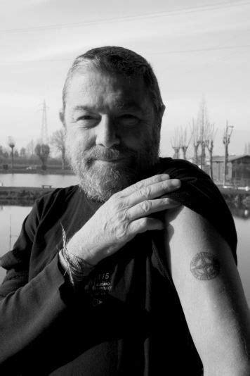 Carlo Rivetti showing off his Stone Island tattoo