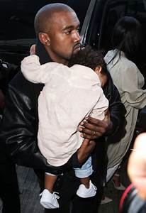 Kanye West cradles sleeping North West as family jet out ...