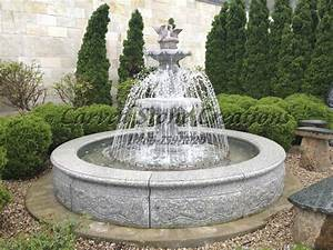 11 breathtaking water fountain designs carved stone for Outdoor patio fountains