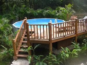Multi level deck for above ground pool landscaping for Above ground swimming pool deck designs