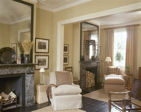 Similarly to sporting equipment, you can use other large objects as wall décor, like the pieces of wood in this neutral, but super chic, living room. colin-and-iona-duckworth-double-reception-living-room-with-beige-walls | Laurel Home
