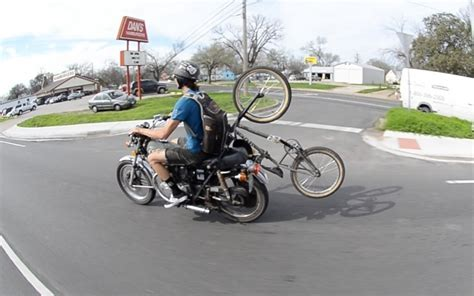 Riding Motorbike And Carrying Bicycle