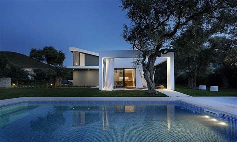 shaped villa featuring large openings clean surfaces  bohemian luxury