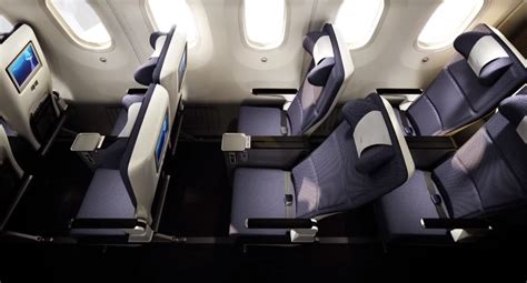 how much to replace compare premium economy cabins seating and services