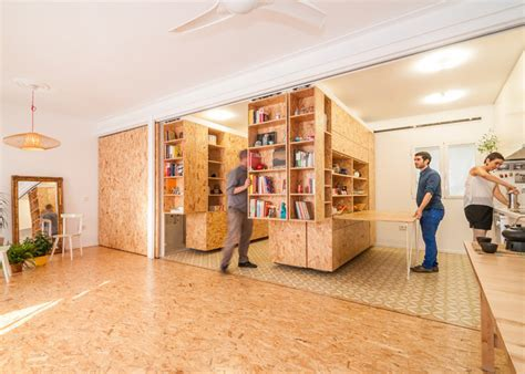 Small Apartment Uses Movable Shelving to Create Endless