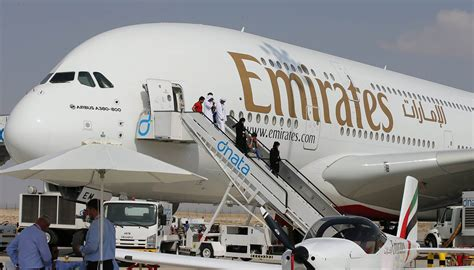 airline carrier requirements emirates airlines reports 82 plunge in profits amid u s
