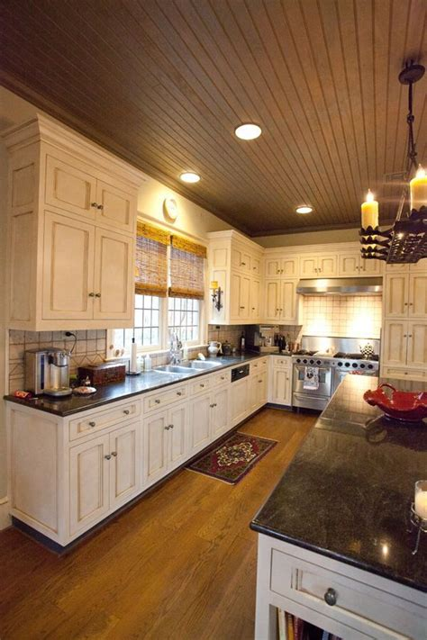 The kitchen has an appealing rustic look to it, thanks to the wooden kitchen ceiling ideas construction. Image result for angled sloped stained beadboard kitchen ...