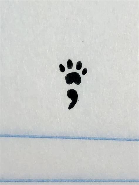 designed paw print semi colon tattoo tattoo