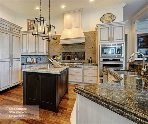 Off White Cabinets with a Dark Wood Kitchen Island
