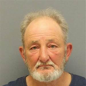 Police: 62-year-old man charged after man was hit by ...