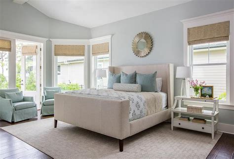 beige wingback bed  blue pillows transitional bedroom