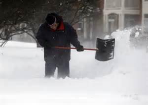 People Shoveling Snow