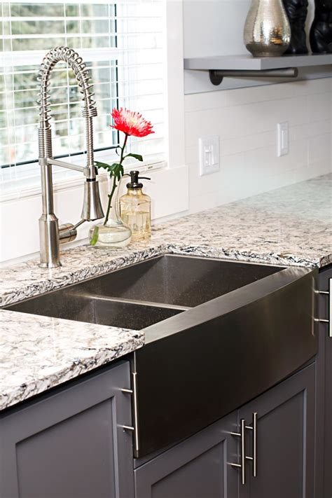 grey stainless apron front kitchen sink with white