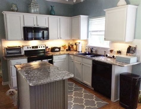 pure white cabinets  dovetail gray island  cabinet