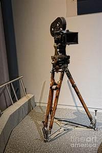 Vintage Movie Camera On Tripod Photograph by Paul Ward