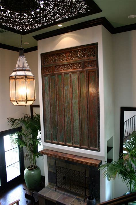 antique carved indonesian door panel  fireplace