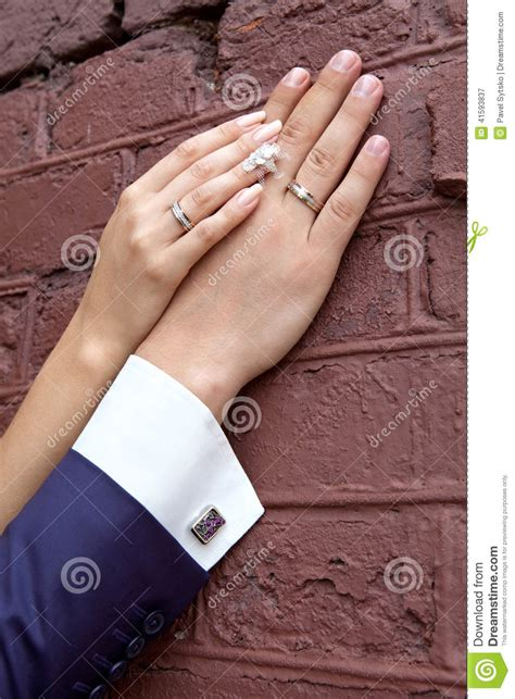 Wedding. Bride's Hand Rests On The Groom's Hand. Just