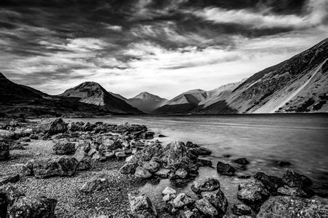 Grayscale Photo Of Mountain Beside Body Of Water Hd
