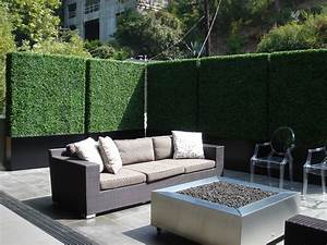 Create privacy on a patio or balcony with tall faux hedges for Patio privacy screen plants