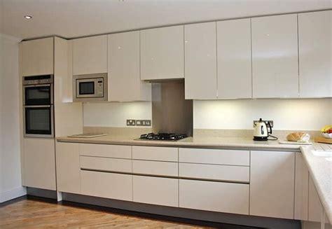 handleless gloss acrylic cream kitchen orderly base