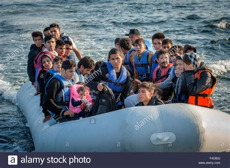 Syrian Refugees Boat by Syrian And Afghan Refugees Arrive By Boat From The Western