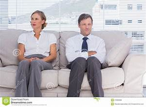 Two Bored Business People Sitting On Couch Royalty Free ...