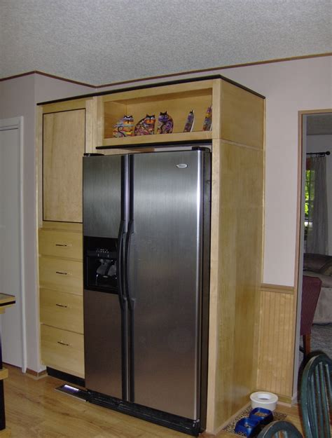 hard maple cabinets  refrigerator surround home