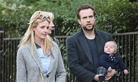 Rafe Spall shows he's a hands-on dad as he cradles his ...