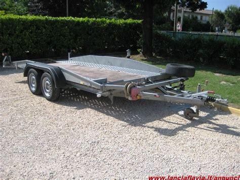 vendo carrello porta auto vendo carrello trasporto auto doppio asse hunbaur